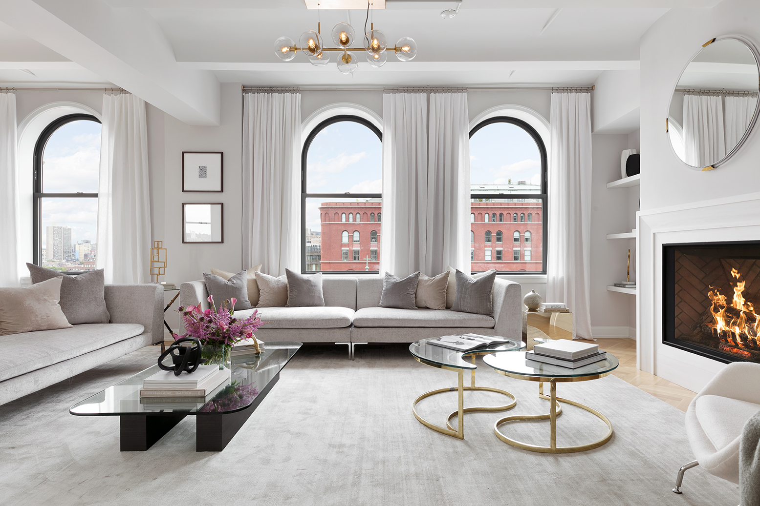 IMMEDIATE OCCUPANCY  With a layout that is both elegant and casual, paired with stunning open views over landmarked West Village townhouses, 12A at the Shephard is truly the perfect apartment. This big, corner 3 bed, 3.5 bath plus media room was designed with both privacy and entertaining in mind. Over 42 feet long, the open great room has beautiful arched, south-facing windows with views of the Hudson and its magical sunsets, a cozy fireplace, barrel vaulted ceilings and white oak herringbone floors. The large windowed kitchen, custom made and hand-painted by Smallbone of Devizes, is situated right off the great room. Showcasing direct views of the Empire State Building, the kitchen has plenty of room for a dining table or sitting area.   A charming library/media room expands the entertaining and living space. Two secondary bedrooms, both with en-suite baths, are in a separate wing from the master suite, creating a sense of privacy. The luxurious master suite, with a large walk in closet/dressing room and an incredible master bath, features hand-crafted mahogany vanities with Lefroy Brooks fixtures, and white mosaic fan tile floors.   The residences at The Shephard have wonderful architectural details including barrel vaulted ceilings, entrance foyers, gallery spaces and special nooks to accommodate built in bookshelves or art. The windows, some arched, are large, Landmark approved, double paned and triple glazed, and floors are solid oak hardwood in a herringbone pattern. The master baths feature hand-crafted mahogany vanities with Lefroy Brooks fixtures, white mosaic fan tile floors, Dolomiti white stone slab walls and pale grey painted millwork. Kitchens are custom made by Smallbone of Devizes, and are outfitted with custom painted and mahogany cabinetry, brass hardware from Valli and Valli. Counters are black absolute granite and backsplashes and islands are white statuary marble. All appliances are from Miele.   Located on a quiet, tree-lined street in the very best part of the West Village, The Shephard has been thoughtfully redesigned, reengineered, and totally renovated to become one of the finest and most special residential buildings in Manhattan. Comprised of 38 unique apartments, the interior design by Gachot is elegant and rich, using only the most beautiful materials to accentuate the building's distinguished character. A new lobby and lovely garden have been created by incorporating a neighboring carriage house into the building's plan. Every detail has been considered, with all new systems and mechanicals of the highest caliber.   With amenities including a basketball court, a gym with Pilates equipment, a golf simulator, steam rooms, an arcade and ping pong club room, and a paneled library that opens to the building's landscaped garden, the building retains an intimate, boutique feel while still providing residents with fantastic spaces to relax and play. The complete offering terms are in an offering plan available from the sponsor file number CD14-0241.