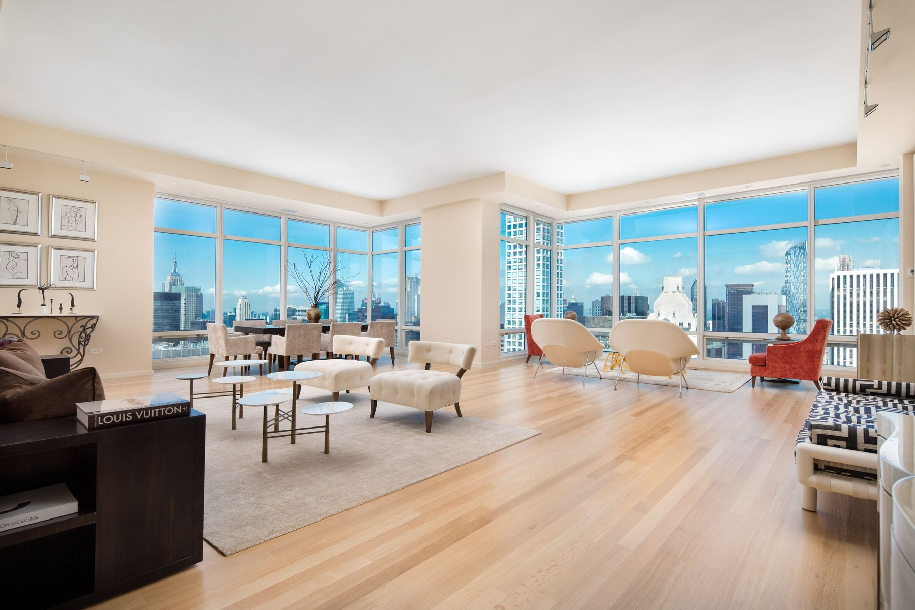 This stunning triple mint 3 Bedroom Condominium is located on a high floor at One Beacon Court, one of Manhattan's most prestigious modern landmarks. Featuring breathtaking panoramic views of Central Park, the masterfully proportioned rooms with 11 foot ceilings and all new floors, include the sophisticated Entry Gallery which leads into the expansive sun-filled Living Room and Dining Room lined with floor to ceiling windows showcasing the Park and the city skyline, the East River and the Hudson River.The spacious all-new custom Kitchen and Breakfast Area is equipped with the best appliances.A private west-facing Master Bedroom Suite includes a custom Dressing Room, large walk-in closet and a lavish Spa Bathroom. In a separate wing is an additional Bedroom with en-suite marble Bathroom, a Library or 3rd Bedroom with en-suite Bath and a Laundry Room complete with a sink and custom cabinetry.Flawless renovation with remarkable finishes and paneling throughout, stateof- the-art lighting, motorized shades, CAC and sound system. One Beacon Court everyday luxuries include: fully equipped fitness center, children's playroom, private entertainment suite, business lounge, doorman, and concierge.