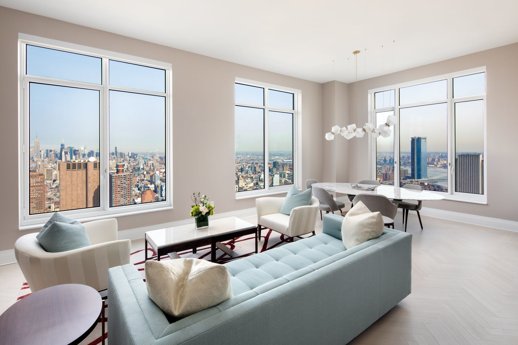 Five star living at the Four Seasons Private Residences New York, Downtown. Positioned on the 62nd floor with outstanding views of the Midtown skyline, Hudson River and East River, this Northeast corner, spacious 3 bedroom, 3.5 bath residence features an oversized corner Living /Dining Room, windowed Eat-in Kitchen with a breakfast area, Master Bedroom Suite complete with a walk-in closet, luxurious en-suite marble bathroom with a deep-soaking tub, separate shower stall, heated flooring and Robert A.M. Stern custom-designed vanities, and two additional Bedrooms with en-suite Bathrooms. Interior finishes include solid oak wood flooring with herringbone pattern in the formal rooms. The Kitchen is outfitted with Bilotta rift-cut oak kitchen cabinetry, top of the line Gaggenau appliances, wine cooler and ample pantry space. Both the stove and the dryer vent to the outside. The newly constructed, Four Seasons Private Residences, masterfully designed by Robert A.M. Stern, is a full service white glove condominium serviced by legendary Four Seasons Hotels and Resorts. Residents may enjoy access to Four Seasons Hotel amenities including a spa and salon facilities, 75' swimming pool, restaurant, bar and lounge, ballroom facilities, and meeting rooms as well as a comprehensive suite of a la cart services. With residences beginning on the 39th floor, the sweeping views are unparalleled. The 38th floor is devoted to private residential amenities including  a fitness center and yoga studio, private dining room, conservatory and lounges with access to loggias, screening room and Roto-designed kids playroom. Pets welcome.Co-exclusivehttps://my.matterport.com/show/?m=hEeGS2NAqQ3