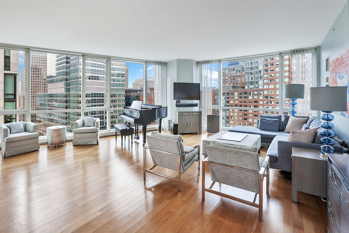 Incredible opportunity at Tribeca's premier full-service Condominium, 200 Chambers Street. Loft-like corner apartment with three bedrooms, three baths and three exposures. Just over 2200 sq ft with high ceilings. This highly coveted A line unit with floor to ceiling windows offers amazing open eastern skyline views, western views towards The Hudson River and southern views of Manhattan. The generous open chef's kitchen features top of the line appliances with tons of cabinetry for storage and a large center island. The first two bedrooms are well proportioned. One has an ensuite bath, and the other an adjacent bath. Each has wonderful light. The master bedroom has been totally customized with a wall of cabinetry, a desk area, and an oversized master bath with a large soaking tub and separate stall shower. Tremendous closet space. Beautiful hardwood flooring throughout the home. Washer & dryer in the apartment.  A great storage unit is included with this sale (valued around $55,000). 200 Chambers has a sleek marble entrance lobby. Amenities in this full-service luxury building include doorman, concierge, live-in super, 24-hour gym, sky-lit indoor pool, resident's lounge, a landscaped rooftop terrace, children's playroom, and a waterfall courtyard garden. Convenient access to Tribeca's world class restaurants & shops including Whole Foods, Barnes & Noble, Bed, Bath & Beyond, Brookfield Place, Soul Cycle, Target, Shake Shack, and The Palm Restaurant. Close to SoHo, Brooklyn Bridge, South Street Seaport, Washington Market Park, and Hudson River Park. Convenient access to major subway, bus, path, & ferry transportation. This is a must-see apartment that will sell quickly.