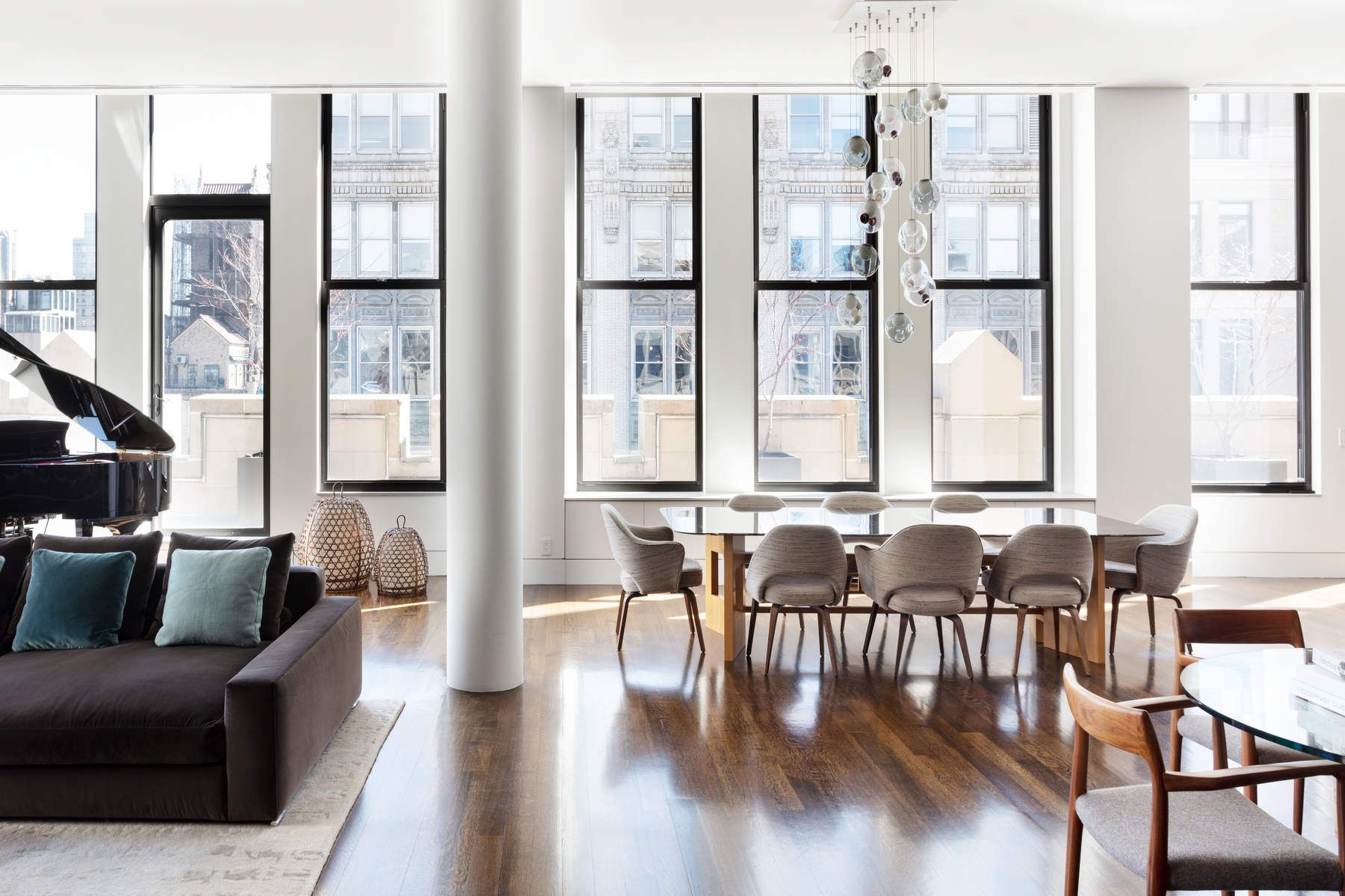 One of New York City's most extraordinary condominium penthouses located in the exciting Flatiron District, this grand loft-like space encompasses approximately 4000 sq. ft., with soaring 12 foot ceilings offering huge cubic volume, three walls of tall oversized windows, three exposures, and 3000 sq. ft. of landscaped wrap terrace imbued with quintessential New York City skyline views, catching a view of the Chrysler Building, the tops of two beautiful golden domes, and the last hand-painted billboard in New York City.    Accessed from a private elevator landing, this pristine 9 room, 3 bedroom, 3.5 bath Penthouse offers an exceptional 50 foot long center gallery leading to a grand 55 foot x 27 foot great room with a view of the Chrysler Building.   This exceptional corner great room has dark walnut stained oak floor, 12 foot ceiling, superb light through three walls of tall wrap around windows, and four doors leading to the landscaped terrace facing north, east and south, which wraps the entire Penthouse in greenery, and all of which offers an exquisite space for comfortable family living as well as lavish entertaining.   The great room includes a stunning state-of-the-art eat-in loft-like open kitchen with 12 foot ceiling and features Calcutta marble countertops and island, slate backsplash, custom walnut cabinetry, top-of-the-line appliances including a Viking stove, Sub Zero refrigerator, Bosch dishwasher, wine refrigerator and ample counter space and storage.   The kitchen has access to the terrace and the outdoor barbeque and dining area under a grand architectural portico of extraordinary scale and proportion.   The expansive master bedroom suite has a 12 foot ceiling, a door leading to the wrap landscaped terrace and a huge window overlooking the terrace, a spa-like en-suite bath of silver travertine and limestone, premium fixtures, double sink vanity,  Kohler oversized soaking tub, separate glass enclosed shower with large rain head shower, and a huge walk-