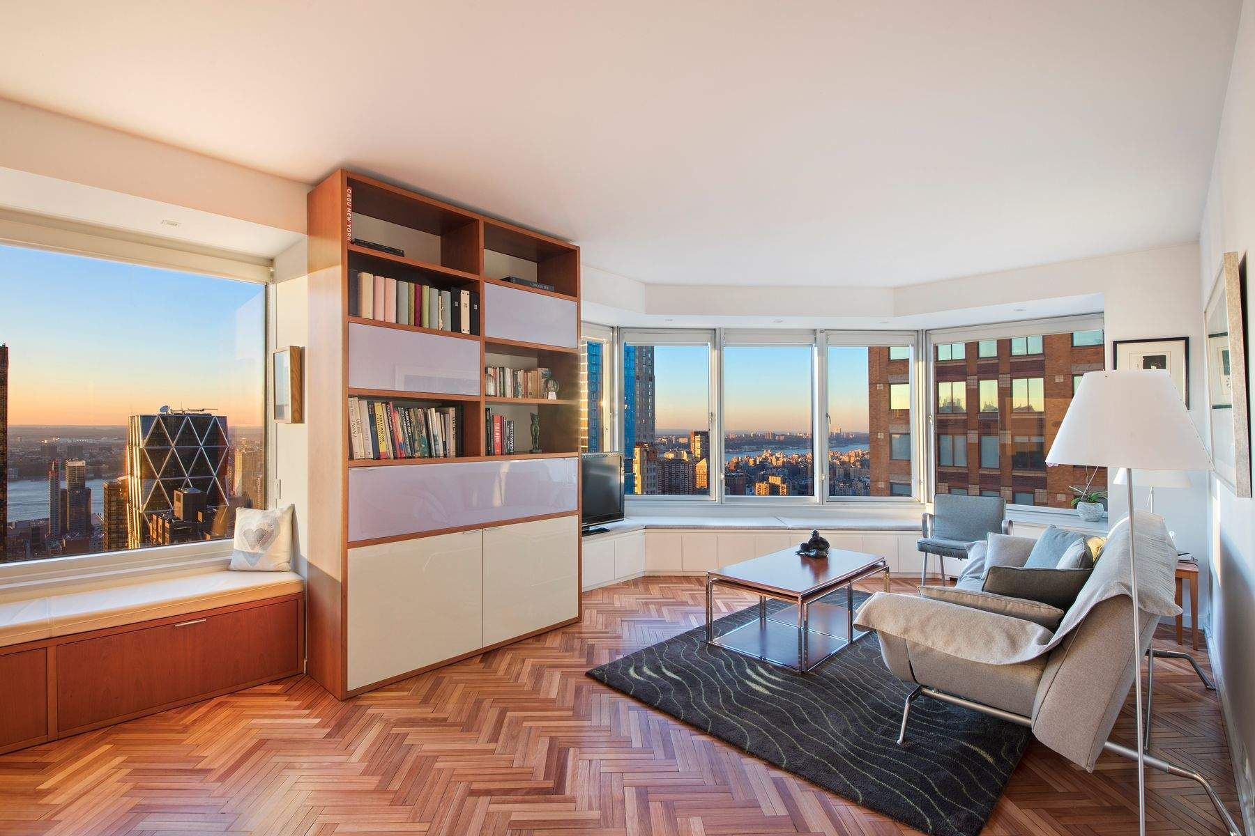 Rare opportunity to easily combine 2 of the Best Lines atop the Cityspire Condominium and create a beautiful +-2,498s/f, luxurious 4 or 5 bedroom home with a washer/dryer room and 3.5 baths!  Occupying the entire southwest and northwest corners of the building, three exposures with stunning views overlooking the Hudson River, with a portion of Central Park, the George Washington Bridge and southern skyline are all yours to enjoy.This aerie offers an open living concept, and windows that are nearly floor to ceiling, allowing light to abound in every corner of every room.  5604 was recently upgraded with custom lighting, beautifully finished herringbone floors and sleek built-ins with living room window seats to enjoy the view.  The windowed Chefs' Kitchen features a clean open design, perfect for celebrity worthy entertaining.  High end appliances are seamlessly fit within the white custom cabinetry. Countertops are luxurious grey quartz.  There are 2 generously sized, separated bedrooms with ample closet space.  The Master Bedroom has a large renovated ensuite shower bath with fine finishes, a lofted window for natural light and double vanity.  The second bedroom, on the other side of the entrance gallery, offers a sunny southern view and a lovely ensuite marble bath.  There is a renovated powder room off the Gallery.  Combining 5604 with 5605, presently a separate 916s/f one bedroom, 1.5 bath, would create a multitude of opportunities for expansive living and privacy; perhaps 2 additional bedrooms, a laundry room and an additional full bathroom.  Alternative floorplan ideas are given.For the combination apartments there is a Special Assessment of $301 per month until May 21 and a Reserve1 Fee of $90 per month.THE BUILDING:  Occupying a prime position in the heart of this iconic city, Cityspire offers World Class, white glove service with a modern lobby and newly renovated hallways and amenities.  The attentive staff include 24 hour Doormen, a Concierge, Handymen, Resident Manager and more.  Wellness and Fitness lovers will immerse themselves in the pristine amenities; a beautiful heated lap POOL with a Hot Tub Jacuzzi, Steam and Sauna Room, a Yoga Room and a new Health Club with locker/shower rooms.  The amenities are endless with a Residents Lounge, Conference room, Children's Playroom, Valet Service and a Garage.   Cityspire is conveniently located near Central Park, Whole Food Market, Theater District, Lincoln Center, Carnegie Hall, Time Warner Center. Pied-a-Terres and pets allowed.