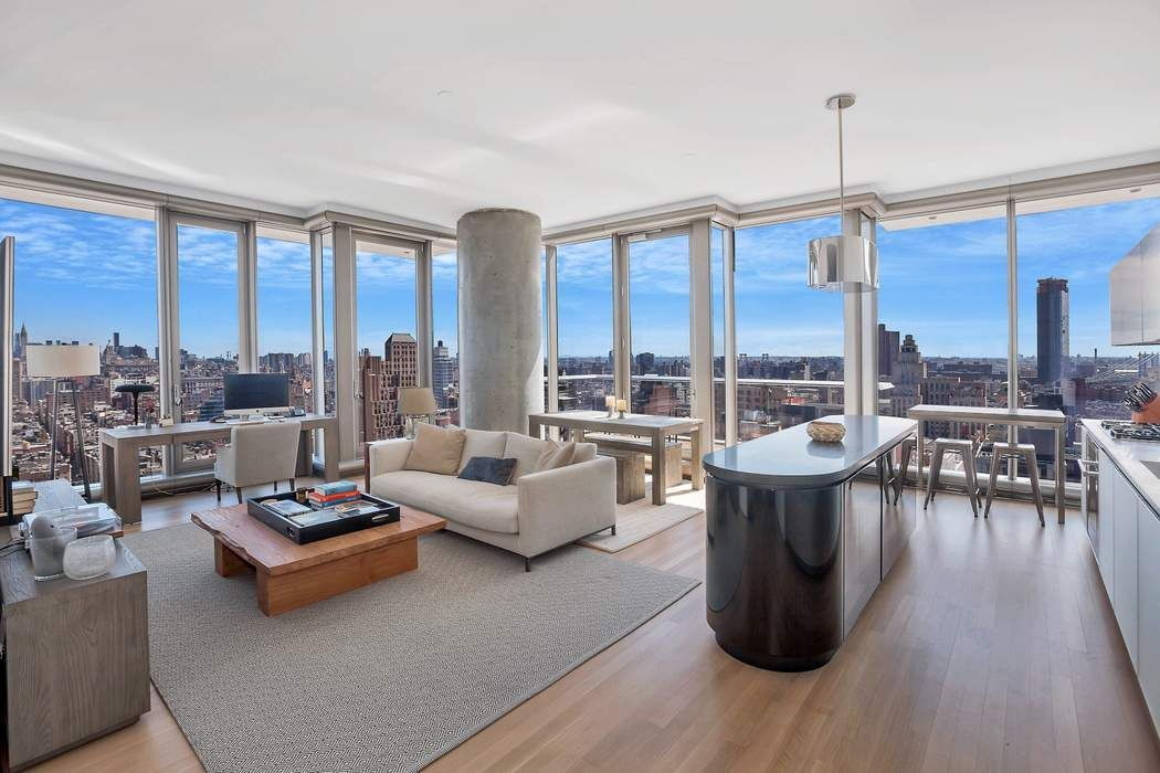 This exquisite, approx. 2,245 sq. ft. +/- northeast corner masterpiece includes three bedrooms, three en-suite baths, an additional half bath and three private terraces off the living room, master suite and second bedroom overlooking stunning views of the Hudson River, New York City Skyline, Manhattan Bridge and much more. Soaring approx. 11' ceilings are complimented by floor-to-ceiling windows flooding the space in natural light. Luxurious custom interiors by Herzog & de Meuron feature a sculptural Absolute Black granite kitchen island and Corian counter tops and seamlessly incorporated appliances include a Sub-Zero refrigerator, Miele oven and cook top with fully-vented hood, Miele dishwasher and Sub-Zero wine-cooler. Satin-etched glass cabinets provide abundant storage.The oversized master suite includes a windowed master bath of travertine and marble with radiant heated floors. Appalachian solid white oak flooring can be found throughout the residence along with a 4-pipe heating and cooling system for year-round multi-zone climate control. Electric shades, California closet installed throughout the unit, and a Miele washer/dryer completes this stunning space.56 Leonard amenities include 24-hour doorman, concierge staff, live-in super, and approx. 17,000 square feet of amenities on the 9th and 10th floors including a Sky Estuary with a 75 foot infinity-edge lap pool, Lounge, Indoor/Outdoor Theatre, Children's Playroom, Landscaped Outdoor Sundeck and Hot Tub, Fitness Center & Yoga Studio, Treatment Room, Steam Room, Sauna, and a Conference Center with a Kitchen.