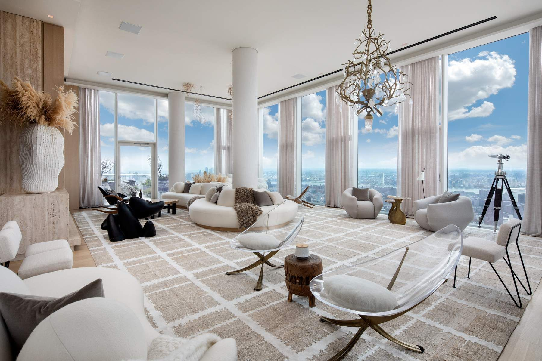 Rare opportunity to own a spectacular, one-of-a-kind, full-floor Penthouse in the heart of Tribeca, perched above the clouds on the 58th floor.  Penthouse 58 is a stunning 5,489 square foot glass-wrapped home with soaring 14 ft ceilings, two Terraces and unobstructed, panoramic views from river to river, as well as iconic NYC skyline views.   No expense was spared in the meticulous renovation of the entire residence by Reber Design Architecture and Emma Donnersberg Interiors.    The elevator opens directly into a formal Entry Gallery, which leads to a breathtaking Great Room with two Terraces and views of the Brooklyn, Manhattan, and Williamsburg Bridges.  The space features a washed oak and Roman travertine sculptural structure, which incorporates a concealed TV and a two-sided wood-burning fireplace, log storage, bench and entry console.  With 745 feet of private outdoor space off of the Great Room, as well as off of the Kitchen and Library, the possibilities for indoor/outdoor living and entertaining are endless here!  The open Chef's Kitchen, overlooking the Freedom Tower and Woolworth Building, boasts a quartzite island and countertops, double Sub-Zero refrigerator, Miele double oven, six-burner cook top with vented hood and two dishwashers and oak and satin-etched glass cabinets that provide abundant storage space.  Off of the Kitchen is a granite and brass 575-bottle Wine Closet and a marble Bar, both hidden behind washed oak doors.  Across the Gallery is the Library with windows framing the Empire State Building, beautiful textured wood sliding doors and floor-to-ceiling millwork boxes adding tremendous warmth and character.    A skyline view central hallway leads you to the home's five Bedrooms, all with En-suite Bathrooms.  The Master Suite features a fireplace, a serene Sitting Room off of the home's wraparound Terrace, an enormous walk-in closet and a spa-like, limestone Master Bathroom with radiant heated floors, double sink, steam shower and deep soaking tub.   Other features include Appalachian solid white oak flooring throughout the residence, 4-pipe heating and cooling system that allows for year-round climate control, motorized solar shades and curtains, Crestron lighting system, high-tech AV and security system, Laundry Room with washer, vented dryer and utility sink and a private Storage Unit in the building.  56 Leonard Street Condominium is an architectural masterpiece, designed by acclaimed firm Herzog & de Meuron, that has changed the skyline of Manhattan.  It is a luxury, full-service building with 17,000 square feet of unparalleled amenities including a 75 foot lap pool with sundeck, state-of-the-art gym, screening room, lounge, private dining room, children's playroom, live-in resident manager and on-site parking.    Call now for your private viewing of this truly special property.