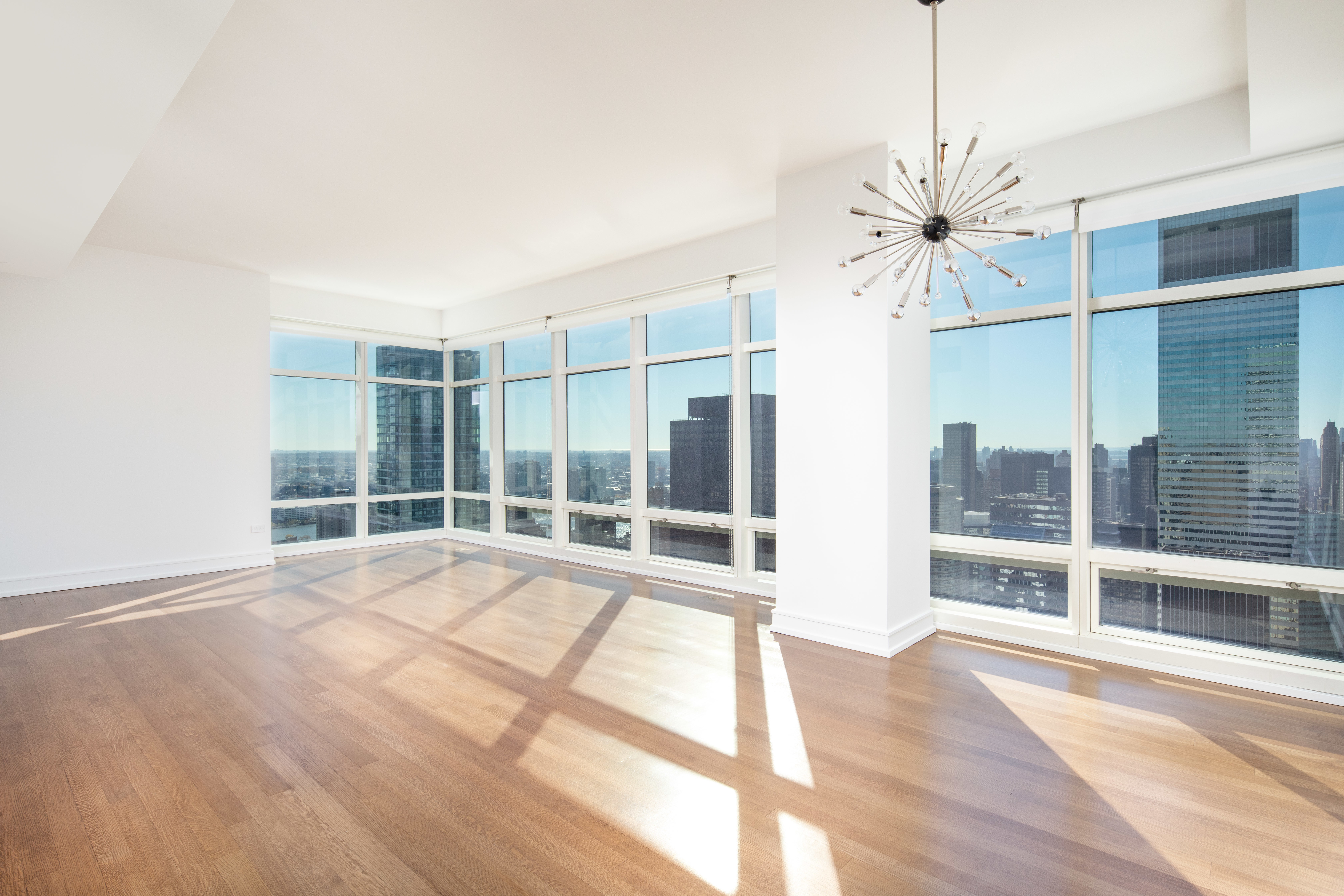 NO BROKER FEE / BROKERS CYOFResidence 38D at One Beacon Court Condominium is a high floor corner two bedrooms, two full bathrooms and a powder room featuring 10-foot ceiling heights, floor-to-ceiling windows, vented washer and dryer in the unit, and beautiful hardwood floors throughout. This over 1,500sqft home offers split bedrooms, a spacious living room with sunny southern and eastern exposures with spectacular open city and East River views. Beautiful kitchen with stone countertops, lacquered cabinetry, top-of-the-line appliances. A master suite features et space including a linen closet and walk-in closet, an elegant marble bathroom with mosaic marble floor, white marble vanity with double sink, soaking tub, separate shower, and generous closet space including large closet, walk-in closet and linen closet. There is a secondary bedroom with open city views, an en-suite bathroom and a large closet.One Beacon Court was designed by the renowned architect, Cesar Pelli, and is a modern classic, with an elliptical-shaped courtyard, inspired by the shape of the Pantheon in Rome. A full-service building with full-time doorman, concierge, and security, on-site resident manager, state-of-the-art fitness room, and lounge on the 29th floor. Located minutes from Central Park, Fifth Avenue, and Madison Avenue fine shopping, dining, and midtown business centers.Available to show Monday through Friday from 10AM to 4PM. No-showing on Saturday and Sunday.