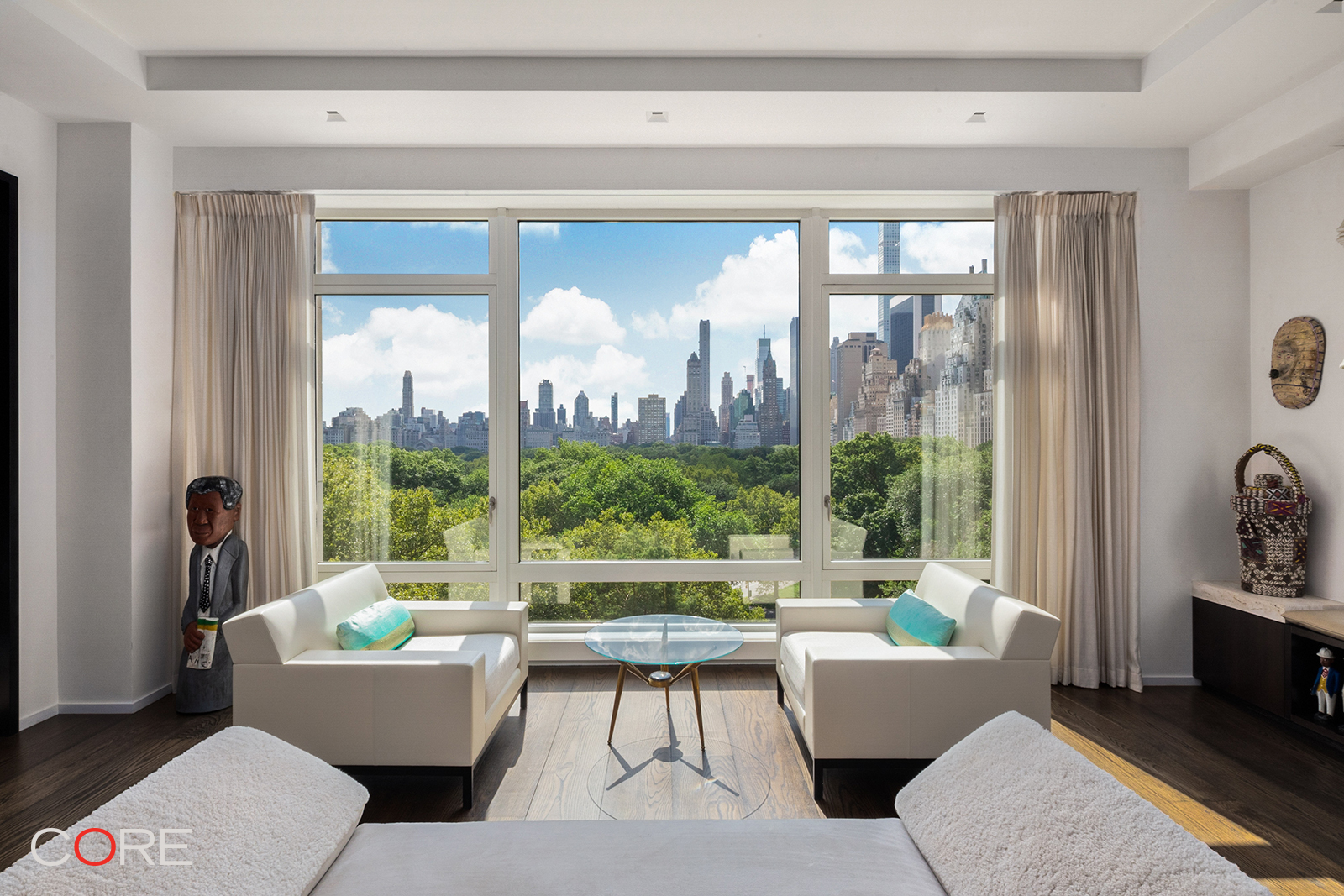 Never before has a property of this grandeur been offered at the prestigious 15 Central Park West. Introducing 9A, a one-of-a-kind home boasting all four exposures, this bespoke residence has been completely redesigned by Jeffrey Beers, offering the highest quality of design, scale and architecture.  Two years in the making, the space was transformed from the ground up with thoughtfully considered, dynamic elements that are complemented by a luxurious palette of materials expertly engineered, artfully crafted, and masterfully executed.  Upon entering, you are welcomed into this sun-drenched, four-bedroom home through a proper foyer which leads to the central gallery. Breathtaking southern and eastern exposures of Central Park are showcased in the generously-sized living room, dining room, library and kitchen. Large, custom floor-to-ceiling glass-panel and bronze sliding doors marry the dining and living room, creating an open yet versatile entertaining space.  The fully renovated, chef's kitchen was reconfigured to highlight views of Central Park and is stylishly outfitted with Solid Zebrawood island countertop and shelving. No stone left unturned, the kitchen is equipped with top-of-the-line appliances including a Sub-Zero refrigerator and wine refrigerator, two Miele dishwashers, and a fully vented Thermador six-burner cooktop with dual ovens, grill and griddle.  Overlooking Central Park, the lavish master suite encompasses complete functionality and comfort with a gel fireplace, two large walk-in closets, and a dressing room. Entirely finished in Italian Silver Travertine, the luxuriously appointed bathroom boasts a deep soaking tub, separate steam shower, two vanities, radiant heated floors and cove lighting which creates a spa-like essence.  Anchoring the west side of the home are three incredibly proportioned bedrooms with ample closet space and custom en-suite bathrooms. A home office, den, and laundry room with Maytag washer/dryer conclude the wing.  Additio