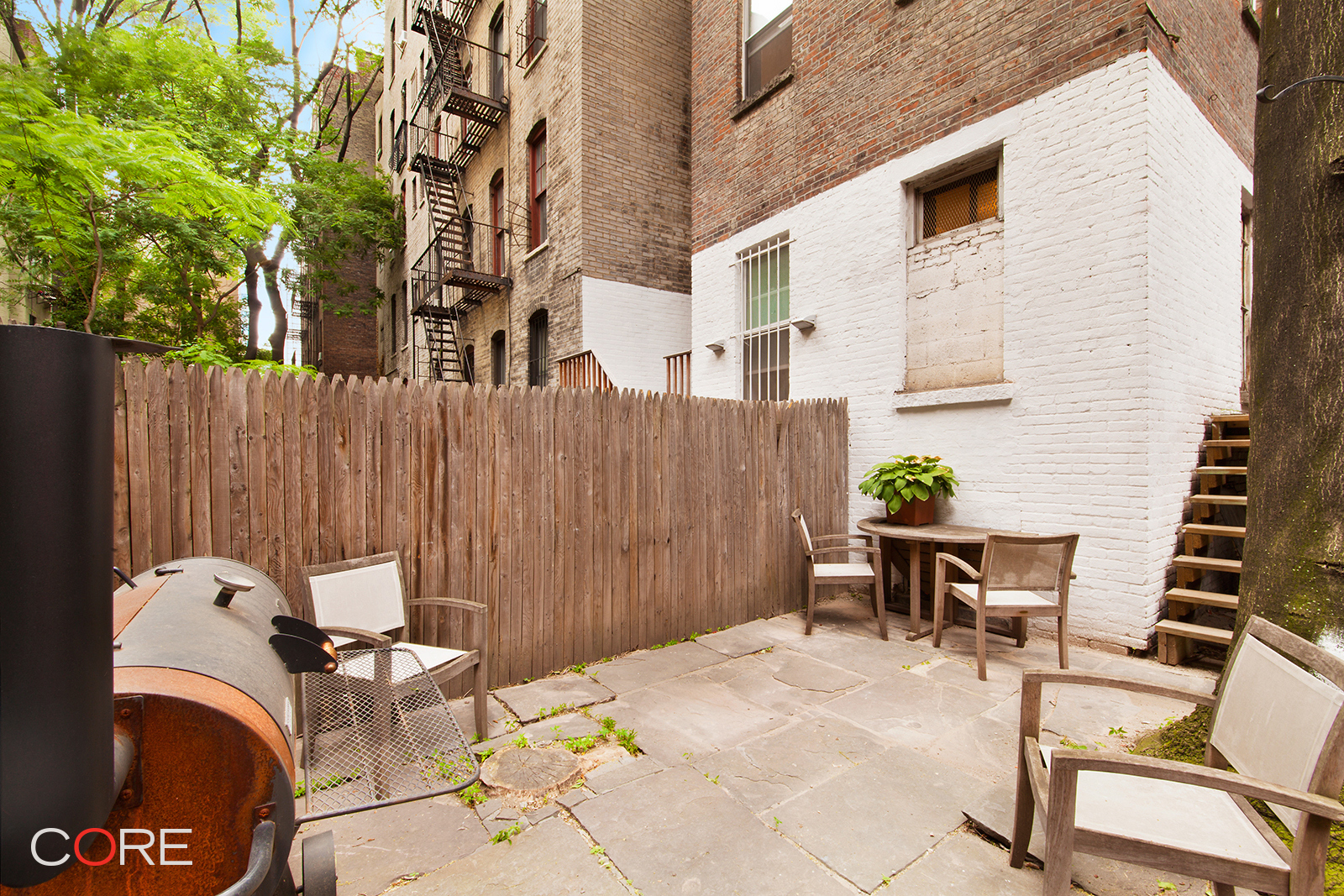 Located in the heart of Cooper Square, this one-of-a-kind, home with private backyard includes a lower, detached commercial level. Currently configured as a one-bedroom, this charming and spacious residential unit is complete with a windowed kitchen with a dishwasher, beautiful arched doorways, wood beams and built-ins throughout. The unique architectural layout includes two residential entrances with ample space for a second bedroom/home office and an additional separate dining room. It is currently leased for 1 year at $5,000 per month.  The windowed commercial retail has a private street entrance as well as a building entrance and a private half bath. Currently leased at $3,000 per month.  The total rent for this property is $8,000/month and has a cap rate of 4%.   Alternatively, the two levels can be connected internally to create one 1,425-square-foot home with a private backyard. Building amenities include a full-time super as well as a resident's laundry room. This property is  accessible to the F/V, B/D and 6 trains.