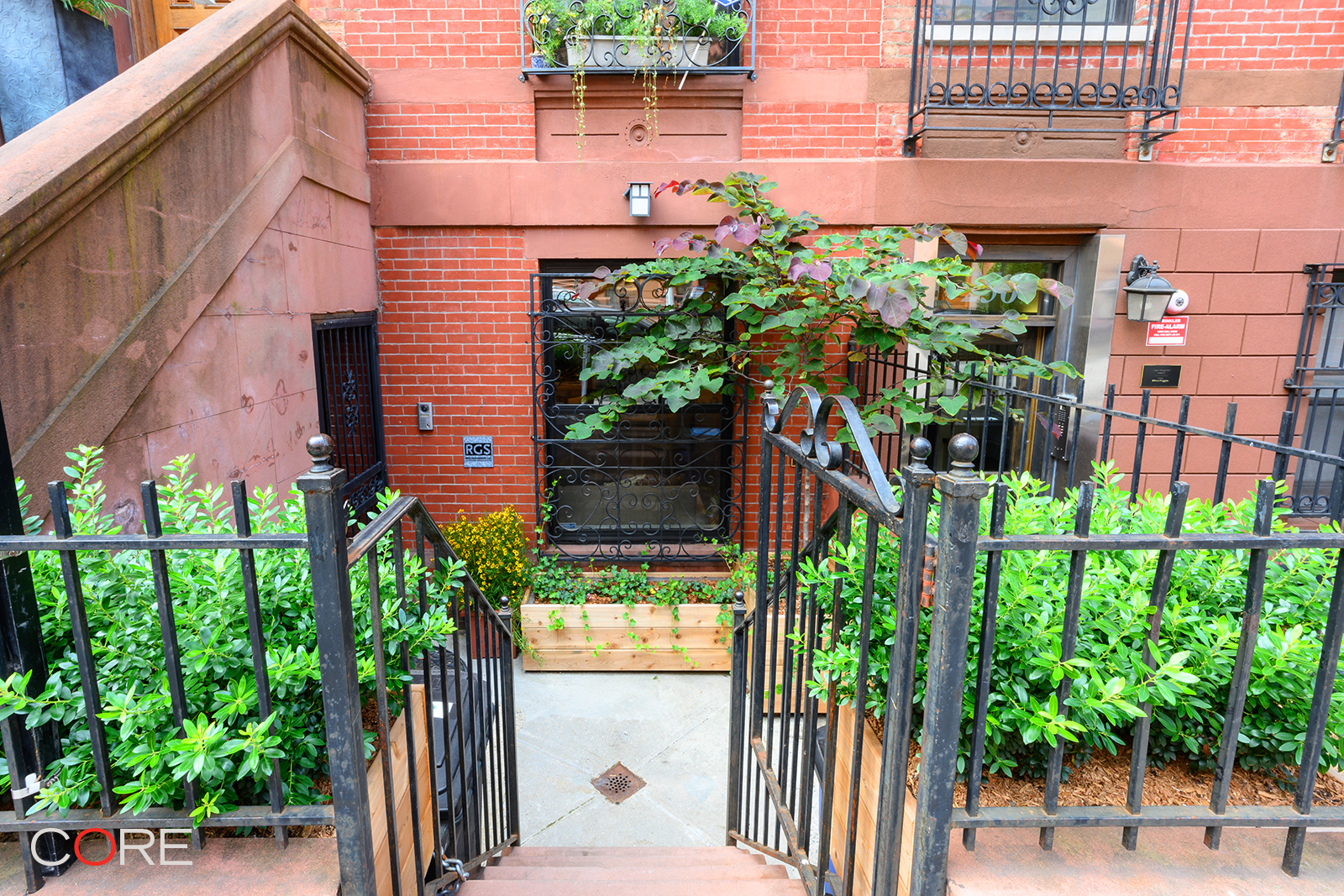 Please copy this URL to view the 3D tour: https://my.matterport.com/show/?m=TEesiMPzTCc&mls=1   With three bedrooms and three bathrooms, this duplex garden condominium in prime Harlem maximizes live/work/play flexibility. Its three outdoor spaces include a private patio and garden and over 2,000 square feet of living space and amenities, all accessible through a private entrance. This home is ready for immediate move-in, with no board approval and no application fees.   Enter this classic townhouse into an expansive 25-foot long open concept living space which is framed by exposed brick and hardwood floors and includes a wood-burning fireplace, a formal dining area, and a chef's kitchen with Wolf and Bosch appliances. The oversized island and breakfast bar are surrounded by a wealth of storage and make entertaining at home easy and comfortable.   The master bedroom is a private retreat with a balcony overlooking the garden, a walk-in closet, and an en-suite bath, complete with a deep soaking tub. A second large bedroom with an adjacent full bathroom also overlooks the serene back yard. The lower level consists of a large open space ideal for recreation or business and has a third bedroom set discretely near the garden entrance, a third bathroom, in-home laundry, and additional storage. The private backyard garden offers a quiet urban oasis where there is ample space for relaxing, entertaining on the patio, and gardening in the uniquely designed and customized raised garden bed area. Central heat and A/C finish this modern and charming home.   254 West 123rd Street is a quaint three-unit, well-maintained condominium, located on a tree-lined street just around the corner from Frederick Douglass Boulevard's action and close to Harlem's parks and green spaces. The building is within close distance to multiple transportation options including parking garages, the A,B,C,D subway express stop at 125th Street, the 2/3 subway on Lenox Avenue, 125th Street's crosstown buses, 