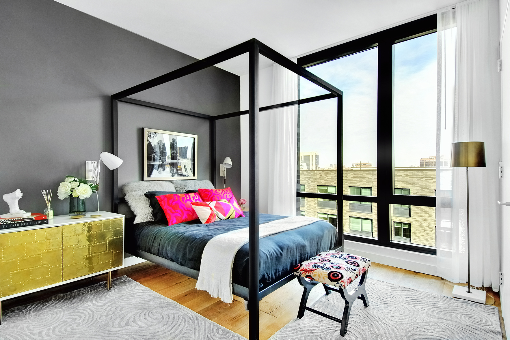 contemporary bedroom with sconces in south harlem, new york