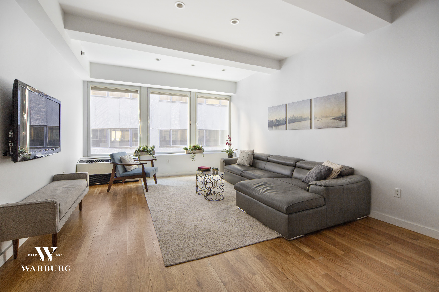 Apartment 6C at the contemporary Be@William Condominium, is an expansive and loft-like convertible 2-bedroom home, with generous ceiling heights and wonderful light from its huge, oversized windows. Renovated to perfection, this stunning 1 bedroom plus large home office/sleeping area spans 1072SF and boasts two full bathrooms and a unique layout with high beamed ceilings and vibrant northern exposures giving both natural and reflective light. An inviting foyer opens up into a spacious living and dining area which is perfect for entertaining or those quiet evenings at home. The large, open chef's kitchen was completely reimagined and remodeled by the current sellers, featuring Silestone countertops, custom white lacquer cabinetry and chic appliances, including a white lacquer Liebherr refrigerator and Miele dishwasher. The size is perfect for the at-home chef and those who love to cook with its phenomenal counterspace and generous pantry storage. A hidden Bosch washer/dryer completes this fantastic kitchen. The king-sized master bedroom enjoys a custom walk-in closet and a beautiful en-suite bathroom with a double vanity sink, classic white subway tile and modern fixtures. The home office area can easily double as a queen-sized second bedroom and it's adjoining bathroom is tastefully graced by a glass enclosed shower and chic subway tile. With white oak plank floors throughout, a wall of windows -  featuring Hunter Douglas window treatments with a blackout shade in the master bedroom - an abundance of closet space and an airy loft feel, apartment 6C is a wonderfully unique and sophisticated home. A separate storage room with custom Elfa shelving on the same floor also conveys with this unit! A true rarity in New York City.One of the Financial Districts' premier condominiums, Be@William is located at the heart of architecturally distinct Fidi. The building offers a 24 hour doorman and concierge service and a sleek PH amenities level which includes the double-height Sky Lounge with indoor and outdoor fireplaces, a pool table and a beautifully landscaped terrace with a wet bar and barbeque grill, perfect for upcoming summer evenings! A state of the art fitness center, bike storage, free WiFi and cable television are also conveniently offered. Just steps to the 2/3/4/5/A/C/E/R/W/J/Z subway lines for easy access into the heart of Manhattan or Brooklyn, 90 William is also just a short walk to the restaurants and shopping of the historic South Street Seaport. There's easy access to run, walk or cycle the 18 miles of continuous riverfront green-way that stretches from 14th street, south under the Williamsburg, Manhattan and Brooklyn bridges, through the lush Battery and Hudson River Parks, and up the Hudson all the way to the GWB. For foodies, get ready to enjoy local restaurants such as Crown Shy, Cipriani's, Felice 15 and Giardino D'Oro, just to name a few. Nightlife is just around the corner including Stone Street, the new Pier 17 (featuring live performances on the roof-top stage which we'll hopefully be able to enjoy again soon!) and countless smaller establishments to explore. The new FiDi has become a destination and is truly the ideal, downtown location.