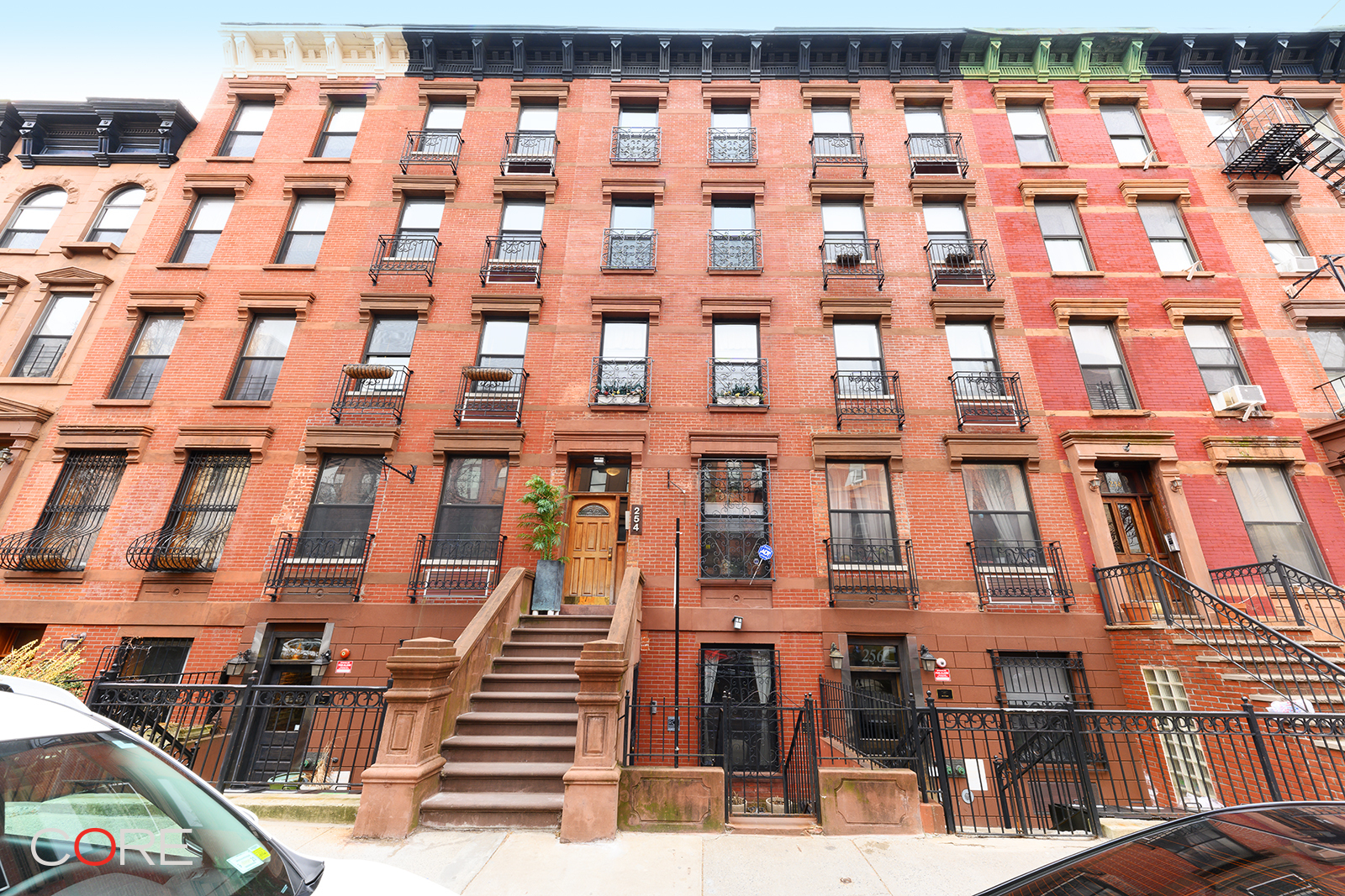 Please copy this URL to view a 3D tour:  https://my.matterport.com/show/?m=KyDmzqVXLMK&mls=1    Enjoy quintessential townhouse living at this boutique, three-unit condominium in prime Harlem.  Units 1 & 2 can be an approximately 4,000 SF home with up to seven bedrooms, six bathrooms, and five private outdoor spaces.  Pre-war details and your architect's thoughtful design can come together to create a welcoming and unique home. With three wood-burning fireplaces, three balconies and a private back yard, this quiet urban oasis offers ample indoor and outdoor living, dining, entertaining and relaxing space.  Choose from two complete chef's kitchens with oversized islands, stainless steel appliances from Wolf, Bosch, and LG, and seemingly endless counter space and storage.   Open-concept living areas off each of the two entries, as well as six bedrooms on the top three levels, provide flexible options for one or more master bedrooms, guest rooms, home offices, and academic pods.  The lower level's floor-through space includes an additional bedroom with a full bathroom, two living areas, additional storage, and access to the private, landscaped back yard.  Two in-home laundry centers with full-size washers and gas vented dryers, central heat and A/C, a security system, video intercom, and storage complete this spacious combination home.  Low common charges are $825 for both homes which also enjoy a J-51 tax abatement.  254 West 123rd Street is a charming three-unit, well-maintained condominium, located on a tree-lined street just around the corner from Frederick Douglass Boulevard and close to Harlem's parks and green spaces. The building is within close distance to multiple transportation options including parking garages, the A,B,C,D subway express stop at 125th Street, the 2/3 subway on Lenox Avenue, 125th Street's crosstown buses, the M10 bus on Frederick Douglass Boulevard, Citi Bike, and Revel mopeds.  Private virtual tours are available as well as private showings, by appointment seven days.  Units 1 and 2 are listed for sale separately. This is a marketing co-exclusive with Compass.