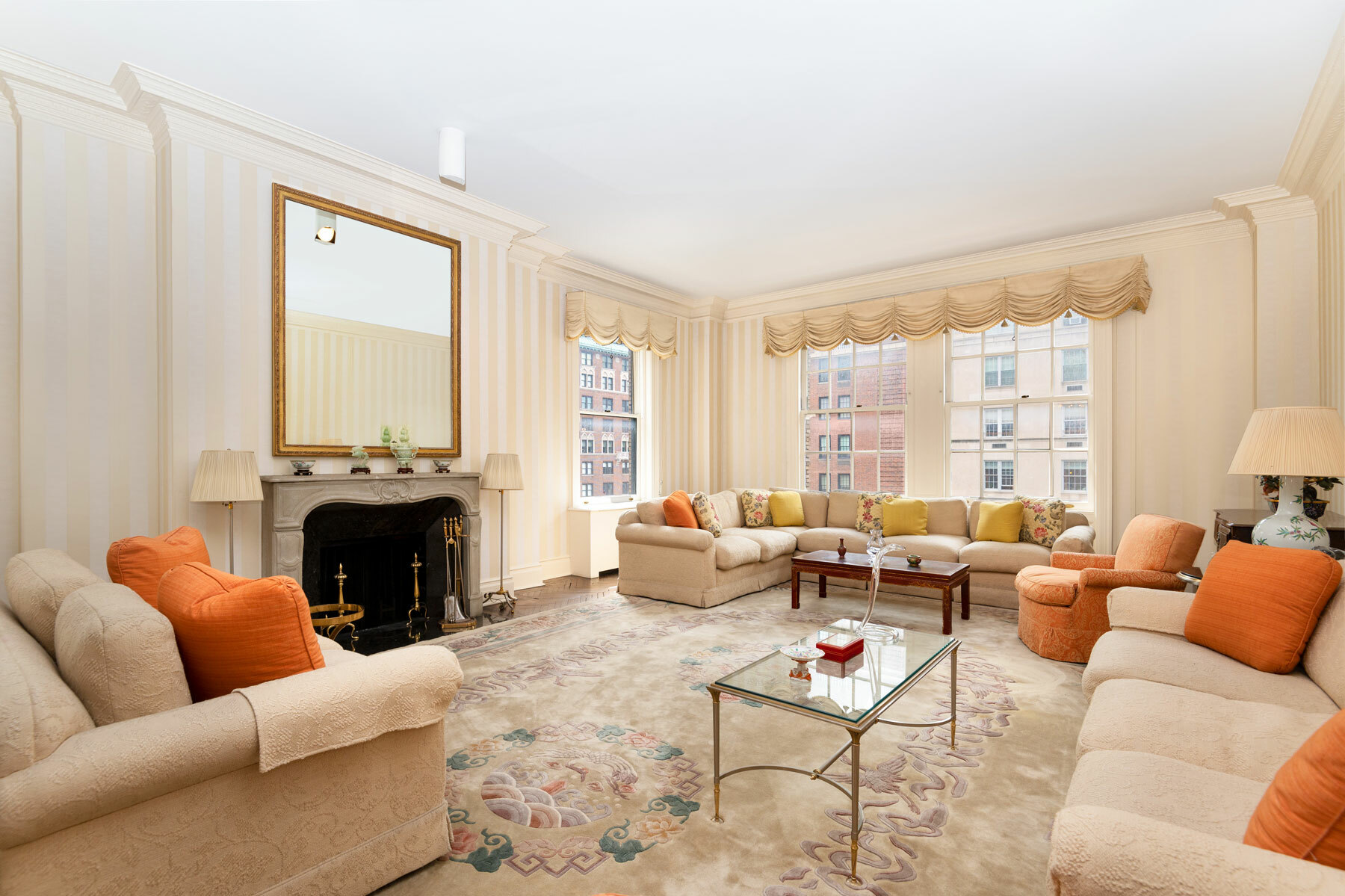 One of J. E. R. Carpenter's celebrated creations, this home exudes a pure sophistication that will transport you to an earlier era of New York City chic. This rarely available, full-floor cooperative at 635 Park Avenue has come to market for the first time in decades.    From the inviting Italian-Renaissance Palazzo façade wrapping the southeast corner of east 66th Street and Park Avenue to the magnificent and inviting circular Foyer, you have the unique opportunity to restore this eighth-floor beauty to its original understated details and elegance.  With a private elevator landing vestibule, this home is accessed through a dazzling and perfectly symmetrical circular foyer leading to an expansive corner living room, connected through double doors to a large dining room.  Each room boasts high ceilings and four elegantly appointed wood-burning fireplaces in the living room, dining room, library/den, and adjacent bedroom. A Primary bedroom with large sitting area and dressing room, two bedrooms with en-suite baths and large walk-in closets, one bedroom currently used as a gym with adjacent bathroom in addition to a maid's room, complete this spacious home.   Chef's dream kitchen with large east-facing breakfast room, laundry room and pantry with easy access to service entrance.    If you love architecture, this is the opportunity you have been waiting for.