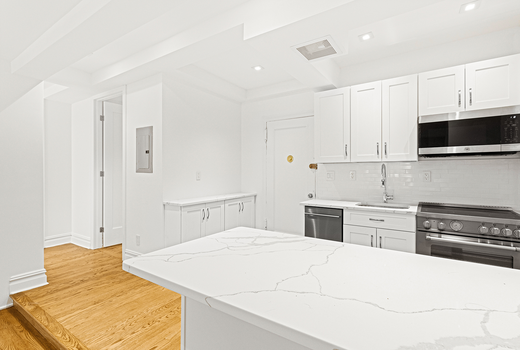 We have a RARE three bedroom/two bathroom SPONSOR UNIT in prime Prospect Heights! No Board Approval!  Welcome, welcome, welcome to 230 Park Place. Built in 1937, this co-op has a beautiful garden entrance that serves as a seamless transition from the tree-laden block. A 24/7 doorman awaits as you turn right down the lobby wing and make your way to the 2nd floor.  As you enter the residence, you are immediately greeted by a sparkling white kitchen. White Shaker cabinets and an ivory beveled subway tile backsplash complement the stainless steel Bertazzoni appliances. The grey streaks in the gorgeous Calacatta Marble outline the piercing white surface which perfectly tie together the duo of colors this huge kitchen space emanates.  The always tasteful step down into the recessed living and dining area changes the feel of the space, but still provides fluidity for entertainment purposes. The area can easily accommodate formal dining if desired.  All three bedrooms are separated to their own wing of the apartment which serves as an internal cue that it is time to rest. The tertiary bedroom has a built-in closet with an eastern exposure. The secondary is larger with has a standing closet unit and two exposures facing east and south. Both rooms are right across the hall from the shared full bathroom.  The Primary Suite is just plain large. The bedroom has an eastern and northern exposure and is buried in the corner of the apartment for privacy. The room has a his and her closet pairing that is adjacent to the entrance of the en suite bathroom.   Both of the residence's bathrooms sport an extremely polished finish. Gorgeous pre-war flooring, excellent tile work, built-in medicine cabinets and an overhead rainfall shower. The only tangible differences are the tile finishes. The shared bathroom is laden with white beveled subway tile and the en suite is adorned in Carrara Marble.  230 Park Place is pet friendly, has storage (waitlisted), bike storage, a live-in super and a ma