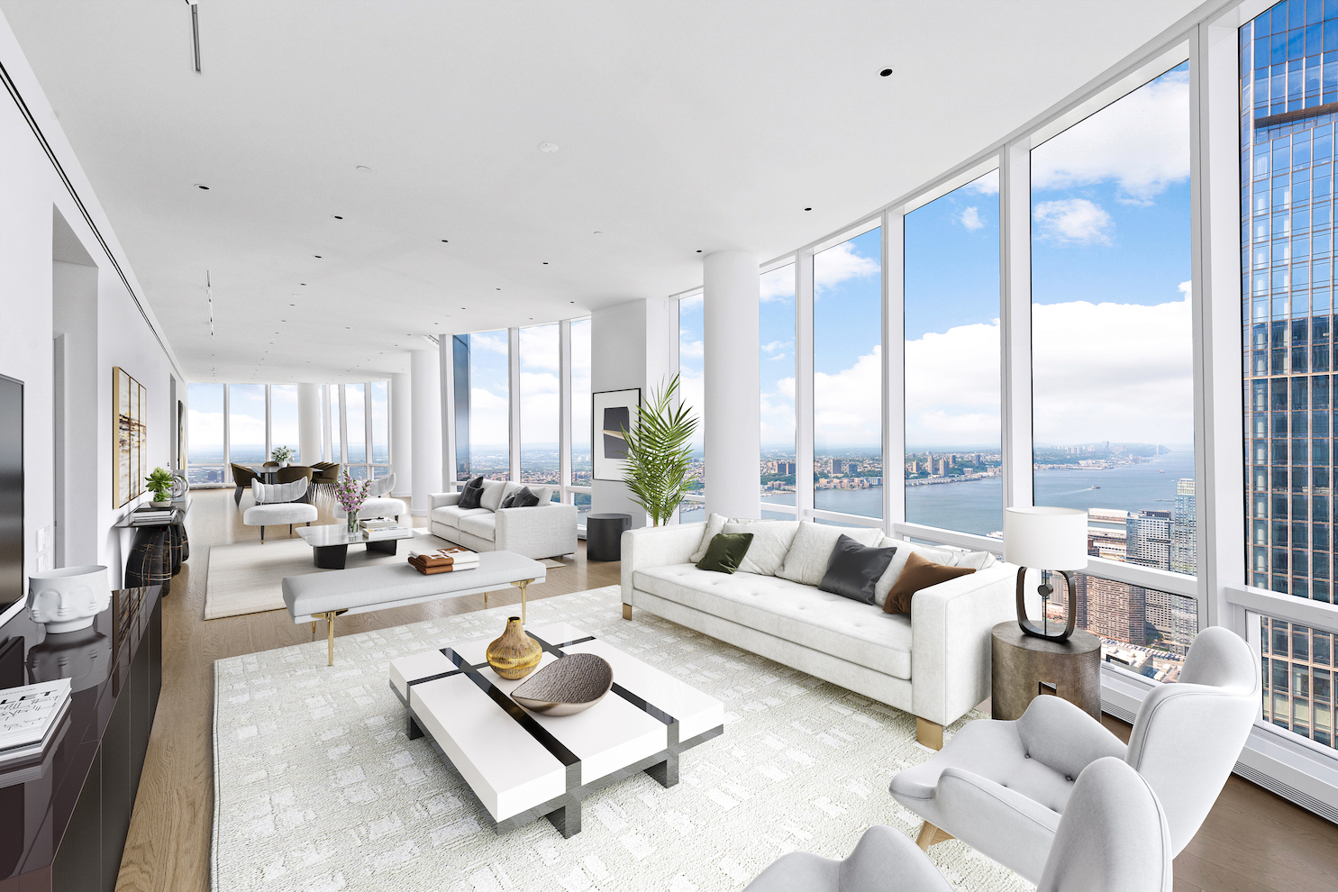 Introducing this never-before-lived-in sky mansion in the exclusive Hudson Yards neighborhood, a sublime 4-bedroom, 5-bathroom condo with a one-of-a-kind combination layout enveloped in shimmering floor-to-ceiling windows.  Additional features of the apartment include beautiful hardwood floors, triple exposure, a side-by-side washer/dryer, soaring ceilings over 10 ft. in height, and expansive views of the Hudson River, the Empire State Building, and the Manhattan skyline.  The home begins with a grand foyer, where residents will enjoy a pair of walk-in storage closets and easy access to a pair of pristine powder rooms. The foyer leads into a massive great room that spans the width of the building and overlooks the Hudson River. Just off the great room is a windowed eat-in kitchen adorned with a huge peninsula, a spacious breakfast nook, sleek marble countertops and backsplashes, custom cabinets, and a suite of fully-integrated appliances from Miele.  The bedrooms are split between two private wings for maximum comfort and privacy. The expansive primary bedroom has couples' walk-in closets, a trio of supplementary reach-in closets, and a windowed en-suite bathroom with double sinks, a walk-in rain shower, an enclosed toilet, and a deep soaking tub. The second bedroom has dual walk-in closets and a full en-suite with double sinks, a walk-in shower, and a separate tub, while the third and fourth bedrooms each ample closet space and full en-suite bathrooms with chic tiles and custom vanities.  Fifteen Hudson Yards is a brand new residential building located in Hudson Yards. Residents have access to more than 40,000 sq. ft. of amenities that include a 75-ft long swimming pool, a state-of-the-art fitness center by The Wright Fit, a private yoga studio, spa suites, a beauty bar, private dining suites, a lounge, a screening room, a business center, a golf club, and an atelier. There is a 24-hour attended lobby and concierge service. The building has easy access to The High 