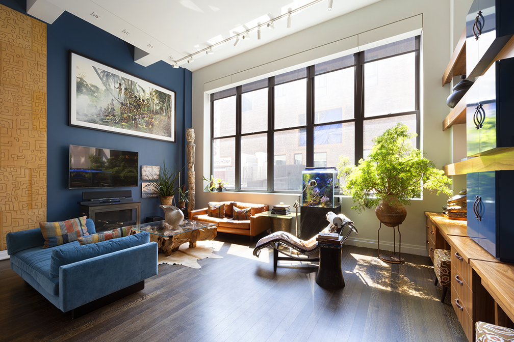 """In the fashionable neighborhood called The West Village residences are primarily brownstones. This iconic full serviced Condominium, known as the Printing House built in 1905, offers this 2,542 square foot residence.   Once industrial, this updated modernized home offers the allure of the neighborhood, the architecture of industrial design but provides a complete redesign with contextualizing modern-day living with an open loft-style home, 15' ceilings, and oversized 11' wall to wall windows.  Situated along Leroy Street is the building's signature 200 foot gated and landscaped mews.  Initially built at the turn of the century, the restructuring of the Italian renaissance with arched entry, oversized cornices, large casement windows, glazed green tile vaulted ceiling, and a sleek canopied steel entry provides the merging of the old and new world.    THE KITCHEN:  Boasting a 25-foot center island, the chef's kitchen includes a Top-of-the-line Wolf wall-oven, microwave and gas stovetop, Bosch dishwasher, Sub-Zero refrigerator, and superb custom cabinetry from floor to ceiling. Ample storage and fine craftsmanship, a vented hood, Caesar stone counters, white glazed tile backsplash, deep sink all with a cool modern appeal complete the chef's kitchen. There is a separate laundry room with a Bosch washer/dryer, wine cooler, and more pantry storage.   THE LIVINGROOM: The pièce de resistance is the massive living room with a fireplace, flat-screen tv, electric shades, and vast ceiling height which allow for large entertaining, hanging of large gallery art with a great distribution of southern light.  On the main level is a generous primary bedroom also with 15'2"""" ceilings. Other fine features are double extra-large walk-in closets, a luxuriously five-fixture spa-like bath offering a deep soaking tub, a dual vanity/sink, separate stall shower, and marble throughout.  Additionally, on the main level is a powder room for the guests.   On the Upper Mezzanine, you will find two """