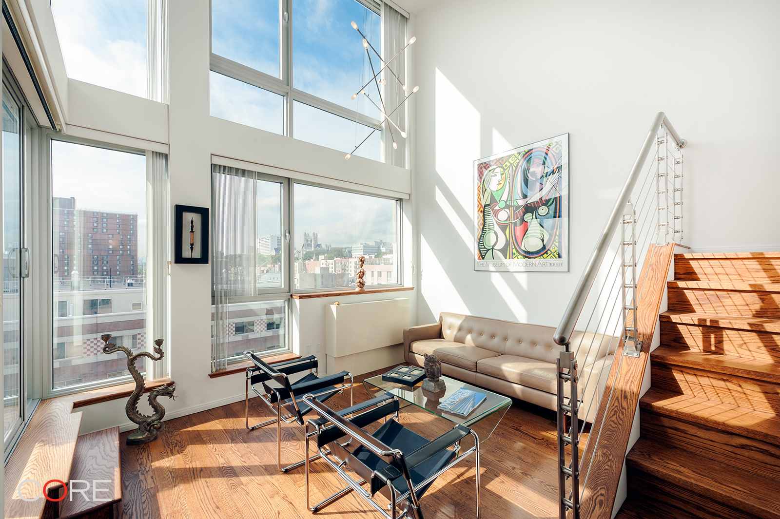 Please copy this URL to view a 3D tour: https://my.matterport.com/show/?m=fqSPcbnHMDT   Welcome home to this rarely-available three-bedroom, two-bath full-service condominium penthouse with a private terrace, and southern exposures over a skyline view of Hamilton Heights and City College's neo-Gothic architecture. Penthouse L is a duplex with nine-foot ceilings throughout, as well as a double-high atrium living room that is over 18 feet tall with double-height windows.  The unit boasts European white oak strip flooring that has been refinished to a rich walnut tone, and Crema Pearl Italian marble in the master bath with Hans Grohe fixtures. The kitchen is equipped with GE stainless appliances, a Positano stone countertop, Applewood veneer cabinetry, and an LG washer/dryer. The internal staircase has been upgraded to include a wood, wire and metal banister that adds elegance and air to the already stunning space. Double-pane windows keep the sounds of street traffic to a minimum, and an intricate system of blinds allows you to manage the sunlight exactly how you want it.  The Langston Condominium set a new standard in the Hamilton Heights/Sugar Hill area for quality of life when it was built in 2006. That standard has endured and the building has continued to be highly desirable. Located only two stops from Midtown on the A or D express trains, building amenities include a 24-hour attended lobby, live-in super, residents' gym, laundry, courtyard, on-site parking (extra fee), and all the conveniences of Jackie Robinson Park and 145th St.