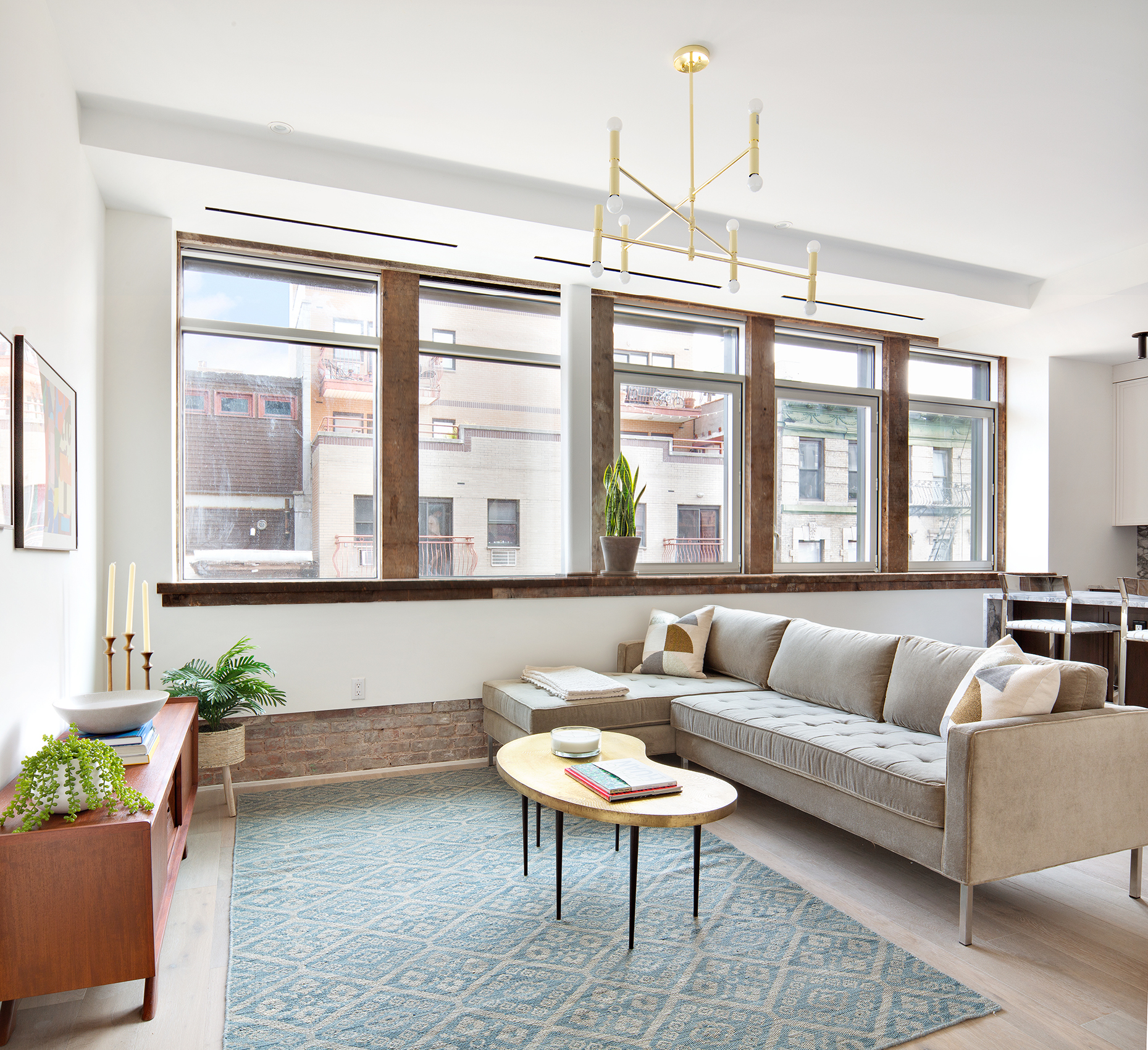 IMMINENT OCCUPANCY  HIGH CEILINGS, EXPOSED BRICK, EACH HOME ONE-OF-A-KIND!  A brand new duplex penthouse boasting a duo of private outdoor spaces, this stunning 3-bedroom, 2-bathroom home is a seamless blend of modern sophistication and traditional Lower East Side charm. Features of the apartment include beautiful wide plank light oak floors, high ceilings, custom built-out closets, a keyless entry door, oversized windows, a convenient in-unit Bosch washer/dryer, a balcony, and a private 262 sq. ft. terrace with a Napolean freestanding grill perfect for al fresco dining, sun lounging, or creating a lush urban oasis.  A welcoming foyer and gallery lead into an open-concept living room, dining room, and kitchen saturated with northeastern light. The living and dining spaces lead out onto a spacious terrace, while the kitchen is equipped with an eat-in peninsula, natural stone countertops and backsplashes, custom walnut lower cabinets, matte lacquered upper cabinets, an integrated InSinkErator, a wine fridge and high-end appliances from Wolf, Asko, and Sub-Zero.   The primary bedroom has a pair of reach-in closets, an attached balcony, and a windowed en-suite bathroom with double sinks, honed natural stone radiant heated floors, walls adorned with polished natural stone slabs and glossy ceramic subway tiles, huge walk-in rain shower, Toto toilet, towel warmer and chic Kohler and Kallista fixtures. The second and third bedrooms have reach-in closets and easy access to a second full bathroom with honed natural stone radiant heated floors, white ceramic matte subway tile walls, a Toto toilet, and chic Newport Brass and Kohler fixtures.   The Library is a one-of-a-kind boutique condominium by The Horizon Group, Isaac & Stern, and Brittany Marom Interior Design. A testament to modern elegance and adaptive reuse architecture, the building incorporates the original 1905 McKim, Mead & White structure that served as the downtown branch of the New York Public Library. The buildi