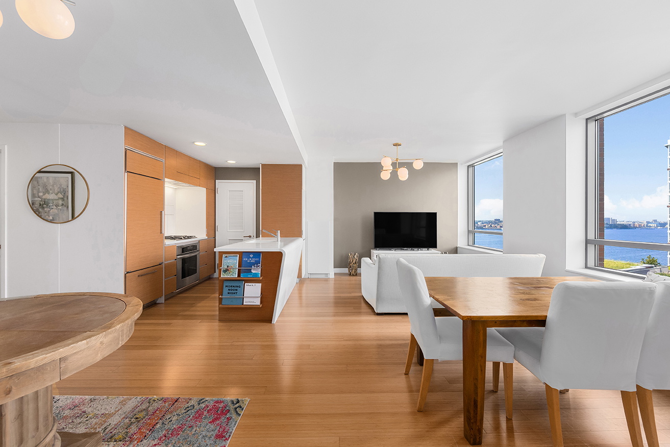 A stunning Battery Park City home graced with incredible Hudson River and city views, this 1-bedroom (flex 2-bedroom), 2-bathroom apartment blends a collection of state-of-the-art finishes with the high-end lifestyle amenities of the LEED Gold-certified Riverhouse condominium.   Features of this 1,092 sq. ft. home include gorgeous eco-friendly bamboo wood floors, air, and water filtration systems, oversized double-glazed insulated windows, northern exposure, and an in-unit washer/dryer from Bosch.  A welcoming foyer adorned with a large coat closet and full bathroom flows into a spacious open concept living room, dining room, and kitchen saturated with natural light. Magical sunset views of the Hudson River will be the backdrop to every dinner. Designed by David Rockwell, the kitchen is equipped with a unique waterfall peninsula, custom sustainable teak-faced cabinets, sleek Corian countertops, and a suite of fully integrated Energy Star-rated appliances from Thermador, Miele, and Sub-Zero.   The tranquil bedroom wing contains a huge walk-in closet, a pair of large reach-in closets, and a windowed en-suite bathroom with a floating double sink vanity, honed travertine walls, teakwood marble floors, chic fixtures, a Neptune Zen soaking tub, and a step-in shower stall.  Riverhouse is a full-service luxury condominium with LEED Gold certification. Residents enjoy exclusive access to a range of world-class lifestyle amenities that include a 50-ft saltwater lap pool, high-end fitness center, billiards room, media café, interior courtyard, exterior terrace, children's playroom, and a pet grooming area. The building has a 24-hour doorman and concierge, a live-in super, on-site parking, a bicycle room, and private storage. Poets House, a branch of the NYPL specializing in poetry, is also located in the building.  The building sits directly on Rockefeller Park and the Battery Park City Esplanade, and it is close to Pier 25, Brookfield Place, Whole Foods, the Hudson River Gree