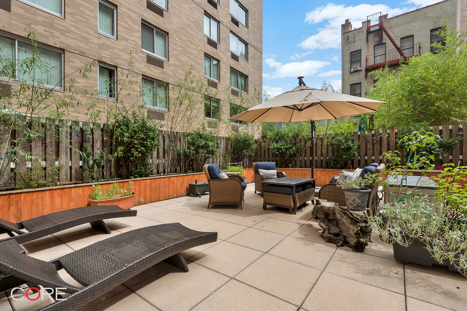 This beautifully renovated two-bedroom, two-bathroom condo has over 1,000 square feet of indoor and roughly 1,000 SF of outdoor space, which is like having a backyard while also living in a doorman building. The split-bedroom layout offers plenty of privacy between the two rooms, particularly with the 23-foot living/dining space in between. All windows look out onto the massive private terrace so you can control your view with your landscaping, decor and furnishings. You'll have a head start on that as the entire fence line of the terrace features a system of custom-made planting containers with drought-resistant plants. There is plenty of space for a seating area, dining area, games, storage, and more.  The sellers recently completed the following upgrades to the apartment:   In the kitchen: Solid maple hardwood cabinets, soft closing doors and drawers, under-cabinet lighting, toe-kick drawers, Caesarstone countertops, marble backsplash, Liebherr refrigerator, Bertazzoni stove and microwave, wine refrigerator, Insinkerator filtered hot and cold water dispenser as well as an additional pantry.    In the secondary bathroom: Marble countertop and flooring, hardwood vanity, deep soaking tub, rain shower head.  General: Maple engineered wood floors, solid hardwood doors, Hunter Douglas shades, built-in electric fireplace, custom lighting.  The Langston is a full-service condominium with a 24-hour attended lobby, live-in super, courtyard, building laundry, resident's gym, and on-site parking garage (extra fee). It is located two stops from Midtown on the A or D trains. Other nearby trains include the C, B 1, and 3 and the 4 and 5 trains are a quick ride on the Bx19 bus to Grand Concourse. The building is not far at all from Yankee Stadium, The Apollo Theatre, Riverbank State Park, NY Presbyterian Hospital, Dance Theatre of Harlem, Harlem School of the Arts, Schomburg Center, Harlem Y, NYSC, Bronx Terminal market Mall, Jackie Robinson Park (swimming, basketball, baseball)