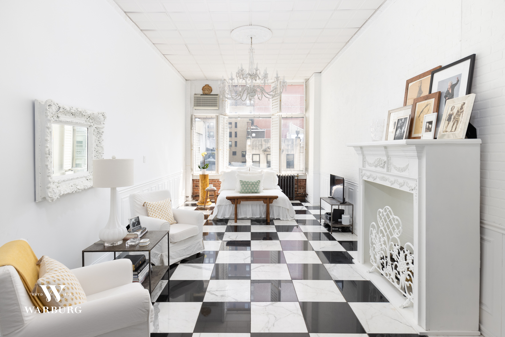 Fifth Avenue beauty with a French twist.  With its soaring 11+ foot ceiling, wall of windows overlooking Fifth Avenue, benchmade cabinetry, and black & white marble floor - this  sweeping 39' salon-style loft is a showstopper. The open kitchen was conceived with the chef who loves to entertain in mind. The decorative wall treatment throughout creates a textured yet pared-down aesthetic with a Parisian sensibility. White plantation shutters, a bespoke set of glass-front arched closets, lofted storage, and a clawfoot tub are some of the unique details that greet you upon entry. Originally built in 1920 as a department store, 372 Fifth Avenue is a full-service building with live-in super and laundry on every floor. The roof terrace has an awe-inspiring view of the Empire State Building. This flexible, pet friendly Coop allows pied-a-terres, co-purchasing, guarantors and subletting.